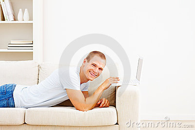 Smart happy man using a laptop