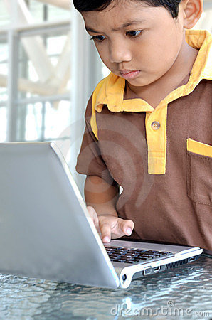 Smart kid using Laptop Computer