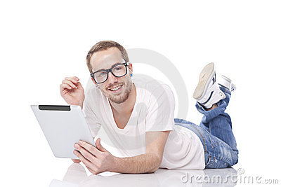 Smart Man With Tablet Computer lying on the floor