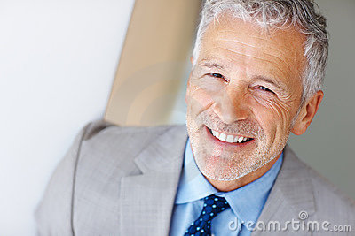 Smart mature entrepreneur smiling - Copyspace