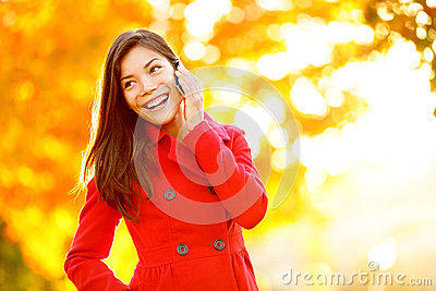 Smart phone Autumn woman talking on mobile in fall