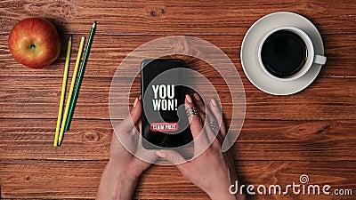 Smart phone displaying YOU WON on screen stock video