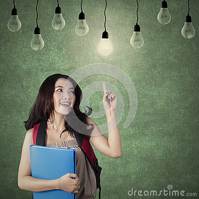 Free Smart Student Choosing A Bright Light Bulb Stock Photography - 58603232