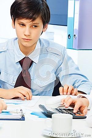 Smart teen boy imagining adult life