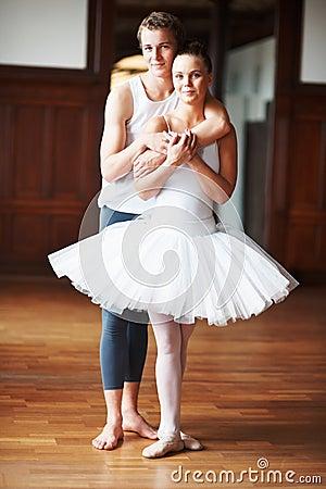 Smart teenage boy hugging his dance partner