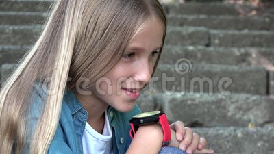 Smart Watch, Child Using Smartwatch Outdoor in Park, Kid Talking at Smartphone stock video
