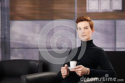 Smart woman having coffee