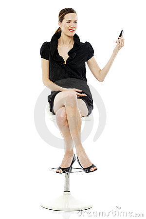 Smart woman sitting on a stool holding a cellphone