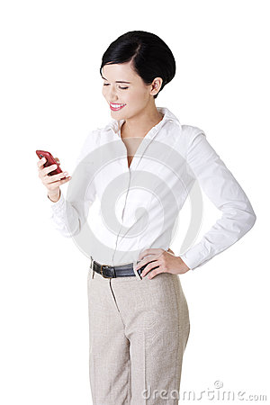Smart young businesswoman using a smartphone