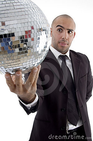 Smart young executive looking at disco ball