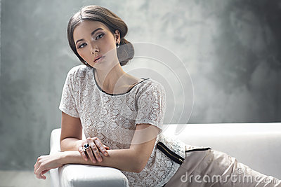 Smart young lady with excellent classic hairstyle