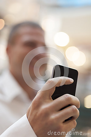 Smartphone in hand of businessman