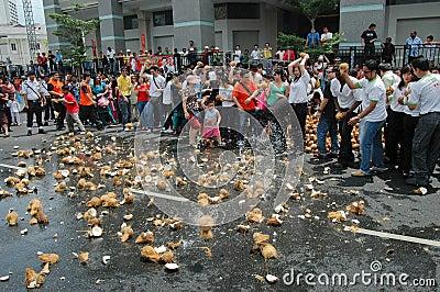 Smashing coconuts Editorial Photo