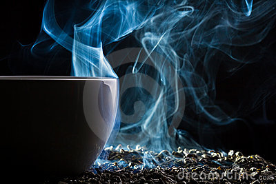 Smell of good tea from a small cup