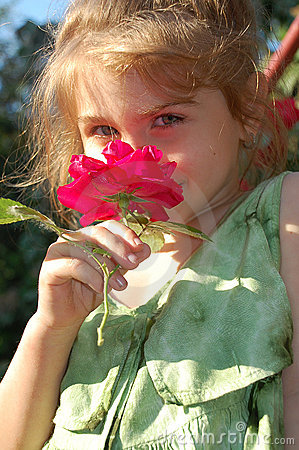 Free Smelling A Rose Stock Images - 5981904