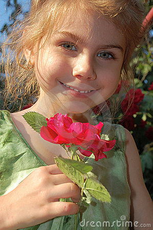 Free Smelling A Rose Stock Photography - 5982072