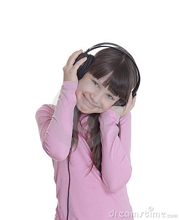 The smile little girl in headphones