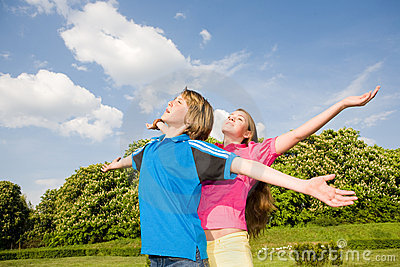 Smile Teens relaxing open hands standing