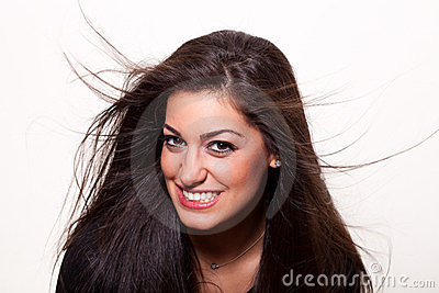 Smile... Young confident woman posing