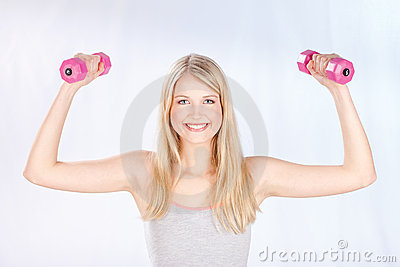 Smiled woman doing fitness exercises