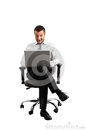 Smiley amazed businessman looking at laptop