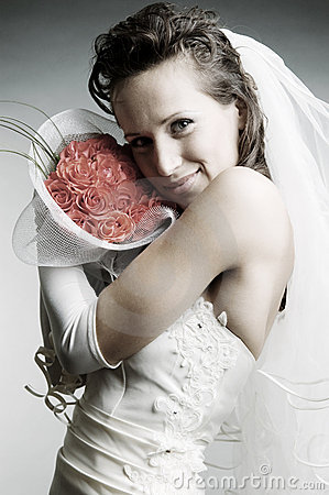 Smiley bride holding flowers