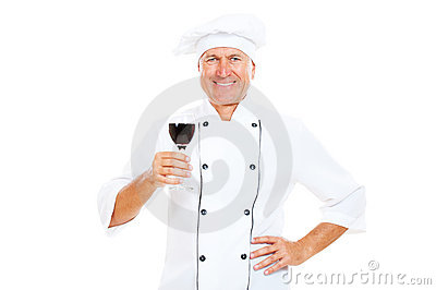 Smiley chef holding glass of wine