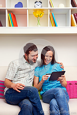 Smiley couple shopping on the internet