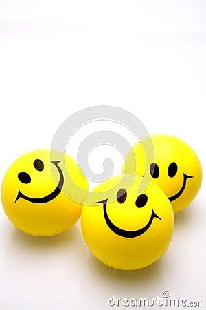 Smiley faces over white