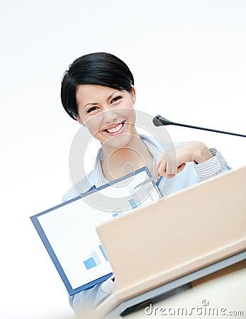 Smiley female speaker at the podium