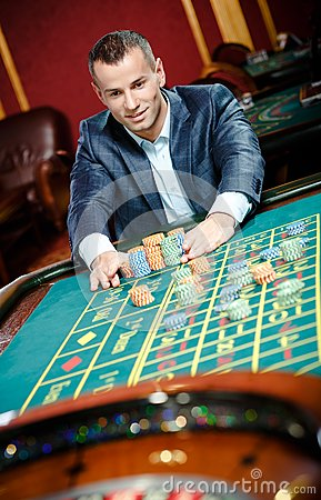 Smiley gambler stakes playing roulette
