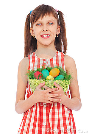 Smiley girl holding basket with colorful eggs