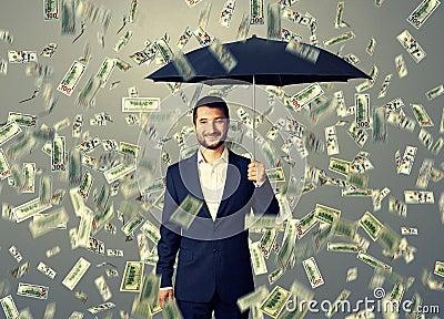 Smiley and glad man under money rain