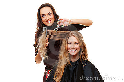 Smiley hairdresser with client