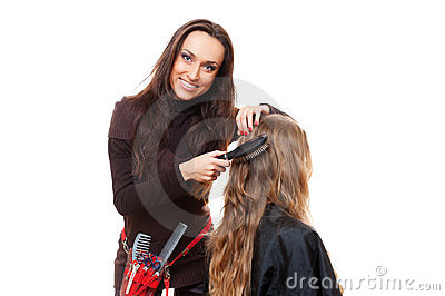 Smiley hairdresser doing hairstyle