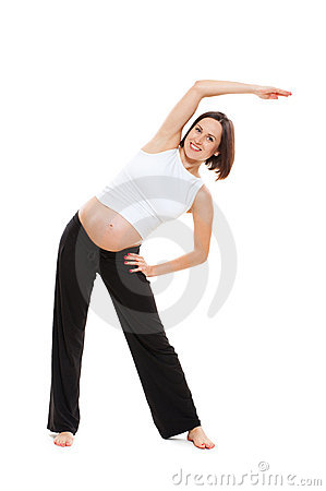 Smiley pregnant woman doing stretching exercise
