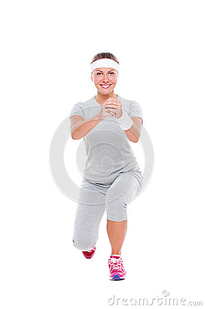 Smiley pretty woman doing aerobics