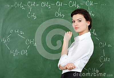 Smiley teacher at the chalkboard