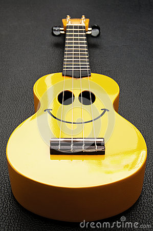 Free Smiley Ukulele Royalty Free Stock Photos - 27911528