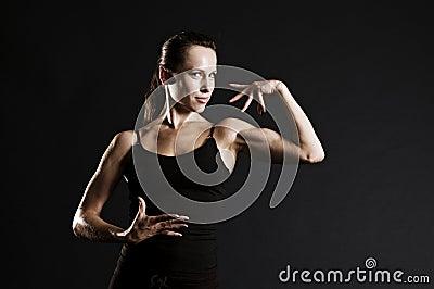 Smiley woman in black sportswear