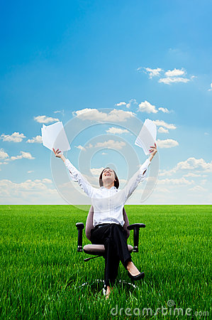 Smiley woman with documents at the meadow