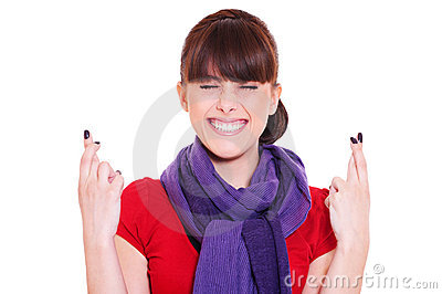 Smiley woman with fingers crossed
