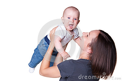 Smiley woman holding excited baby
