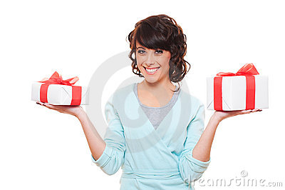 Smiley woman holding gift boxes