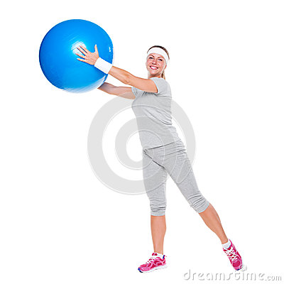 Smiley woman training with ball