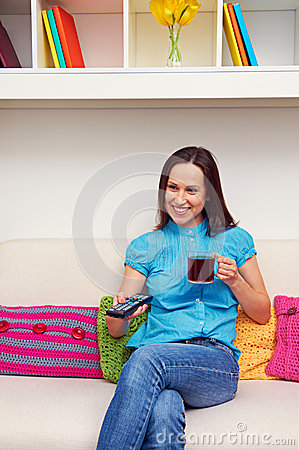 Smiley woman watching tv