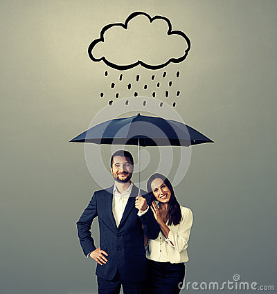 Free Smiley Young Couple With Black Umbrella Royalty Free Stock Photo - 42081295