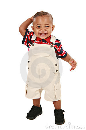 Smiling 1-year old baby boy standing facing camera