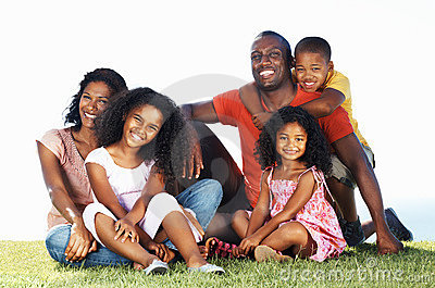 Smiling African American family in park