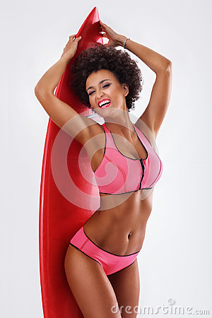 Free Smiling African American Girl With Surfboard. Royalty Free Stock Images - 96359609